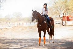 Cute girl horseback riding Royalty Free Stock Photo