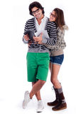 Cute girl hug her boyfriend. From his  back full length in white background Royalty Free Stock Photo