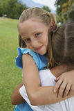 Cute Girl Hugging Her Friend Royalty Free Stock Photos