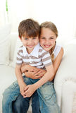Cute girl hugging her little brother Stock Photo