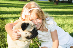 Cute girl  hugging with lovely dog at the park Royalty Free Stock Image