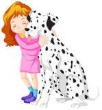 Cute girl hugging pet dog Stock Photography