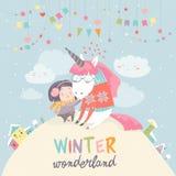 Cute girl hugging unicorn. Winter wonderland Royalty Free Stock Image