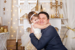 Cute girl hugs her father. Christmas time royalty free stock photo