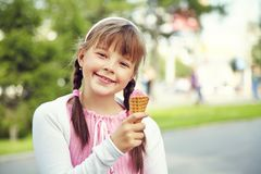 Cute girl with ice cream. Portrait of a cute girl with ice cream on a walk in the park. child outdoors Stock Photos