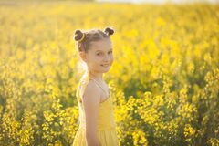 Free Cute Girl In A Yellow Dress Having Fun In The Field Of Flowering Rape Stock Photo - 178555640