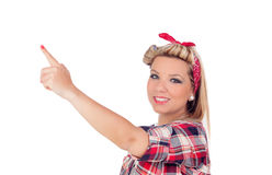 Cute girl indicating something in pinup style Royalty Free Stock Photos