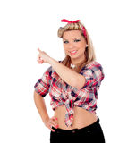 Cute girl indicating something in pinup style Royalty Free Stock Photo