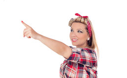 Cute girl indicating something in pinup style Royalty Free Stock Photography