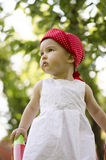 Cute girl with an innocent look. Cute girl having fun on playground slide Royalty Free Stock Images