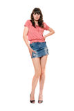 Cute girl in jeans mini skirt Royalty Free Stock Photography