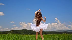 Cute Girl Jumping In Green Meadow stock footage