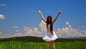 Cute Girl Jumping In Green Meadow stock video footage