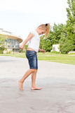 Cute girl jumping on one leg Royalty Free Stock Images