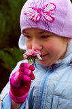 Cute girl kid smelling flowers portrait Stock Photo