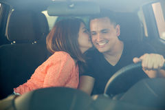 Cute girl kissing the driver Stock Image
