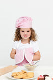 Cute girl with kitchen gloves Stock Image