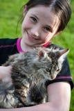 Cute girl with kitten Stock Photos