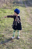 Cute girl with a kitten on hand is pointing Royalty Free Stock Images