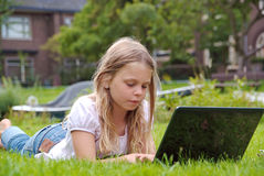 Cute girl with laptop Royalty Free Stock Photography