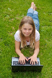 Cute girl with laptop Royalty Free Stock Photos