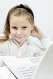 Cute girl with laptop indoors Royalty Free Stock Photography