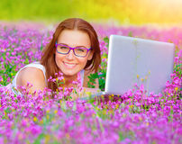 Cute girl with laptop outdoor Royalty Free Stock Image