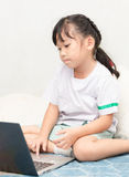 Cute girl with laptop pc at home. Education, school, technology and internet concept - Cute girl with laptop pc at home Royalty Free Stock Image