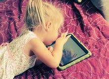 Cute girl with laptop Stock Photos