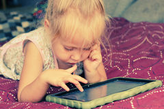 Cute girl with laptop Stock Photography