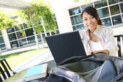 Cute Girl on Laptop at School Royalty Free Stock Image