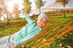 Cute girl laying on net of hammock in the park Royalty Free Stock Image