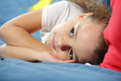 Cute girl laying on sofa Royalty Free Stock Photography