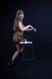 Cute girl in leopard print dress. Cute girl in leopard dress on a chair stock photo