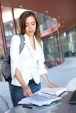 Cute Girl at library on College Campus Royalty Free Stock Image