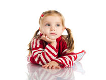 Cute girl lie on sweater and gumboots Royalty Free Stock Image