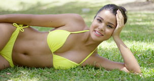 Cute girl lies on grass in exotic park stock footage