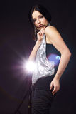 Cute girl in light beams Royalty Free Stock Photos