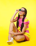 Cute girl like doll dress look in stereo glasses Stock Image