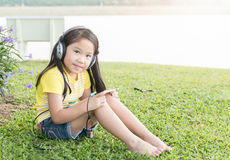 Cute girl listen music from mobile phone Stock Photo