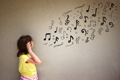 Cute girl listen to music notes next to textured background