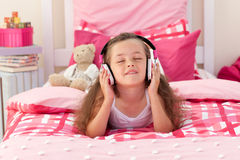 Cute girl listening music with headphones Royalty Free Stock Images