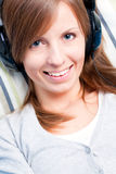 Cute girl listening to music Stock Photo