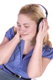 Cute Girl Listening to Music Stock Photo