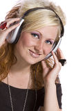 Cute Girl Listening to Music Royalty Free Stock Images