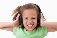 Cute girl listening to music Stock Image