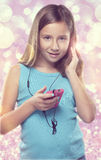 Cute Girl Listening to Music. A young girl listens to music on her phone royalty free stock photos