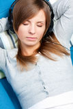 Cute girl listening to music. Eyes closed Royalty Free Stock Photos