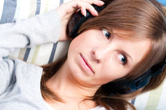 Cute girl listening to music. Eyes open Royalty Free Stock Images