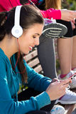 Cute girl  listening to music with  smartphone after exercise Stock Images
